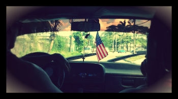 A taxi, driven by Dari, featured an American flag.